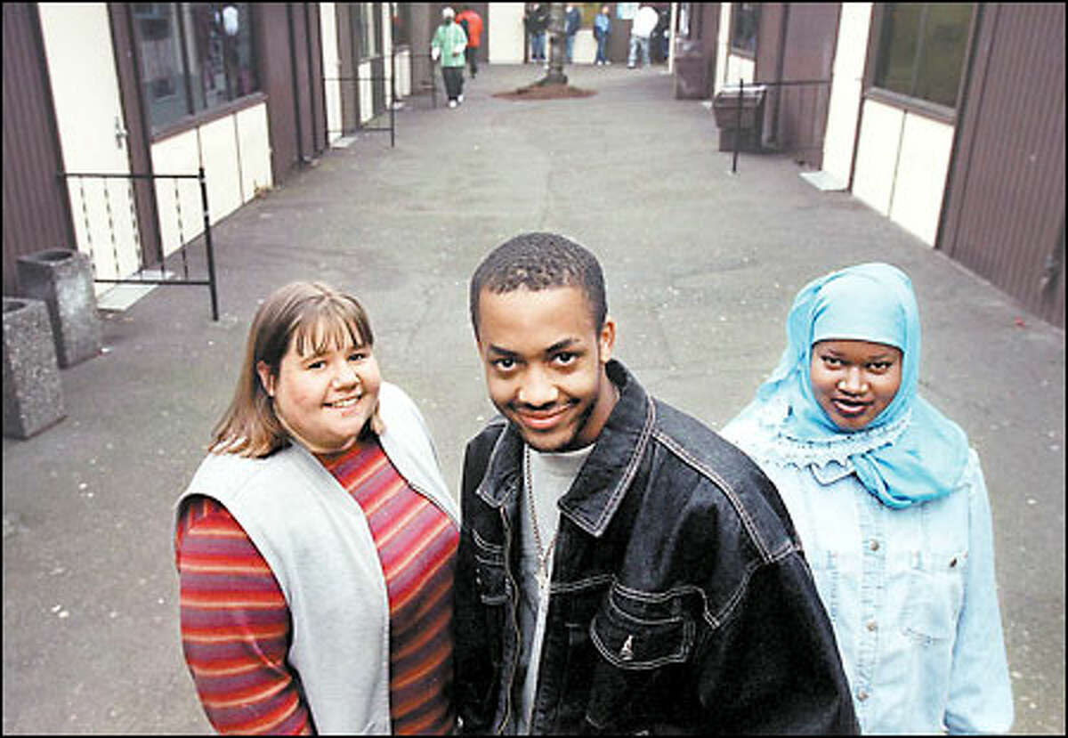 Jamie Adams, left, Justin Knox and Fadumo Abdi earned Hidden Winner awards, given to students who overcome big obstacles to stay in school. They attend Middle College High School at Seattle Central Community College.
