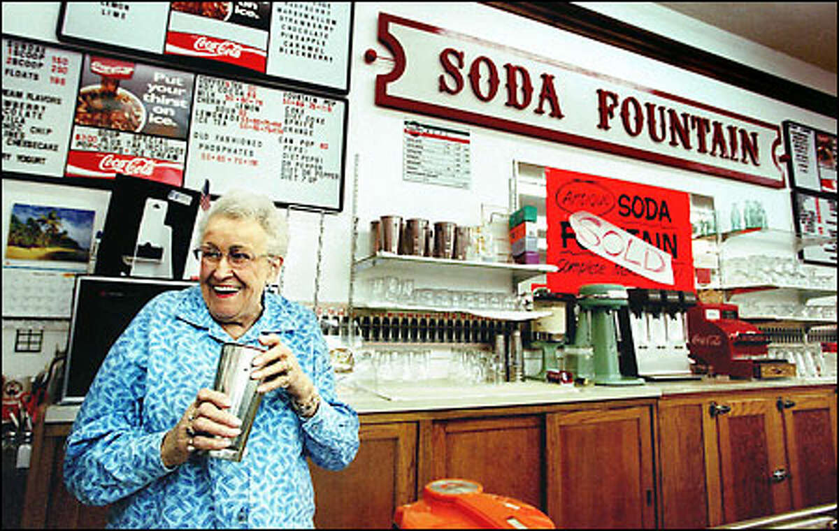 Mabel Running, a 28-year employee of the Owl Fountain, talks to a visitor about the store, whose closure deprives Wenatchee of a cornerstone in its history.