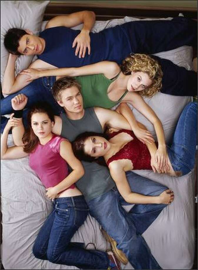 "High school basketball players and their cheerleader girlfriends create a tangled web in The WB's ""One Tree Hill,"" starring, clockwise from top, James Lafferty, Hilarie Burton, Sophia Bush, Chad Michael Murray and Bethany Joy Lenz. Photo: The WB / The WB"