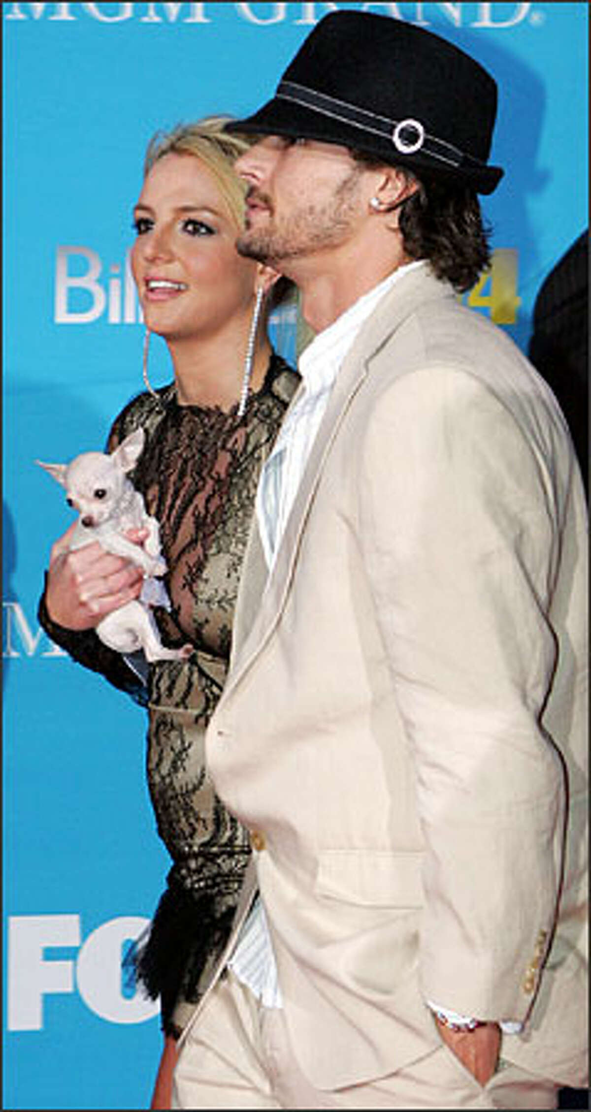 Talk about a thin plot line! Britney Spears and husband Kevin Federline (shown here at the Billboard Music Awards in December), are going to do a reality series for UPN television network. The series will document their courtship, engagement and wedding. (Can't that be covered in about one 30-minute episode?) Let's hope Britney's dog is in the cast. The little cutie could be the most interesting character on the show.