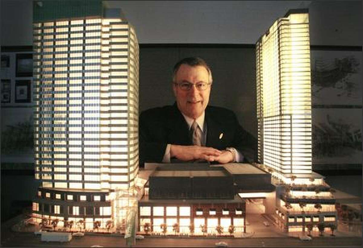 Kemper Freeman Jr. and a model of his project, Lincoln Square, which will feature a 27-story office tower, left, and a 42-story hotel/condo tower.