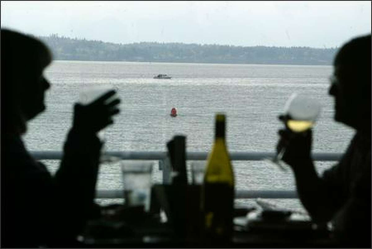 Ray's Boathouse isn't the standard-bearer it once was, but we never get tired of drinking in that view.