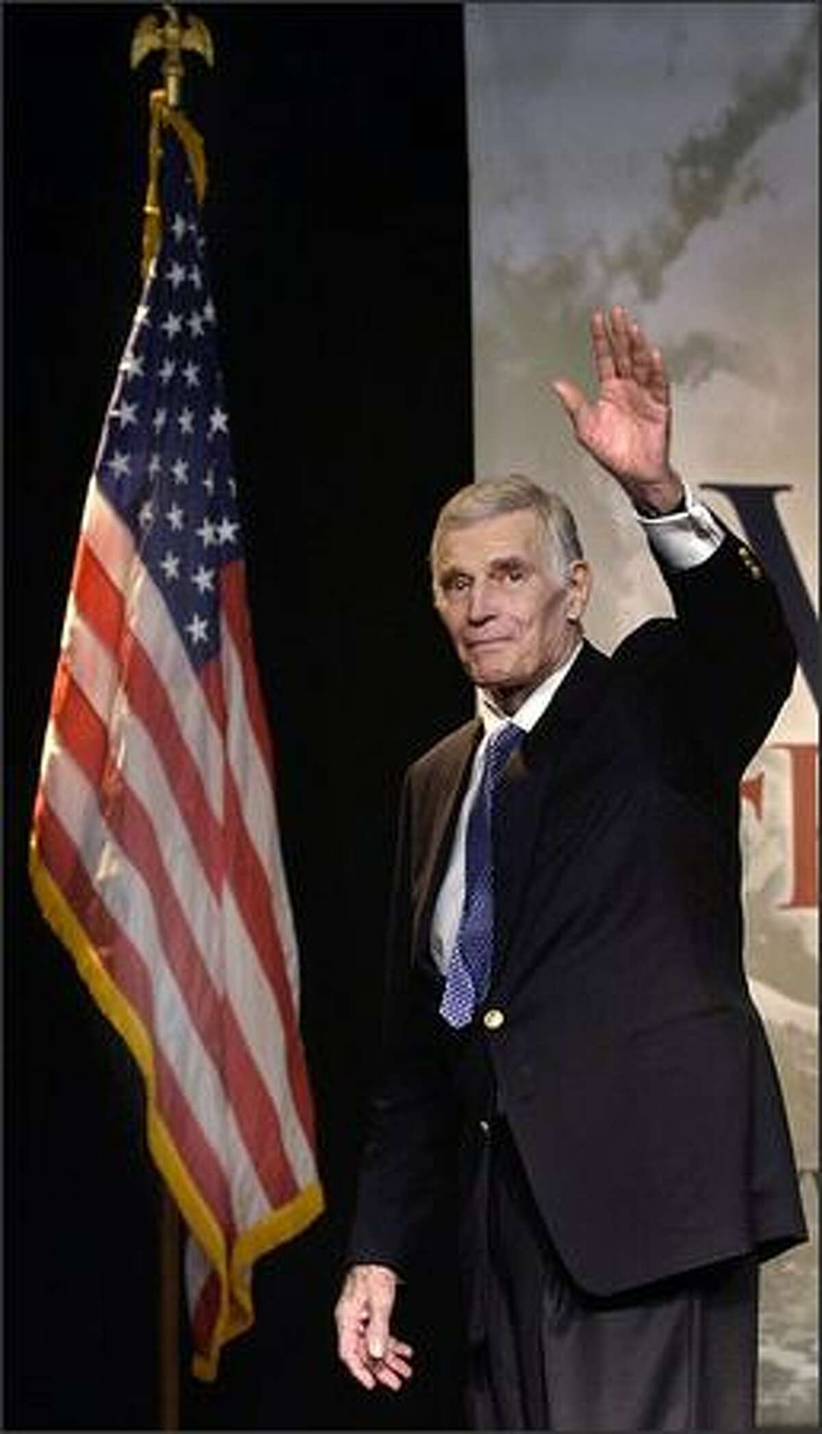 National Rifle Association President Charlton Heston waves on stage during an NRA Rally in Oklahoma City, Okla., on Oct. 31, 2002.
