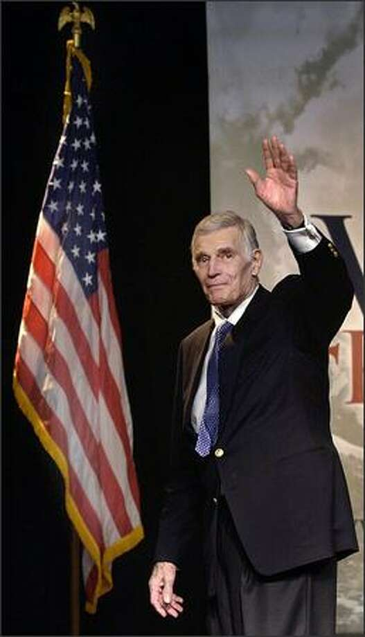 National Rifle Association President Charlton Heston waves on stage during an NRA Rally in Oklahoma City, Okla., on Oct. 31, 2002. Photo: Associated Press / Associated Press