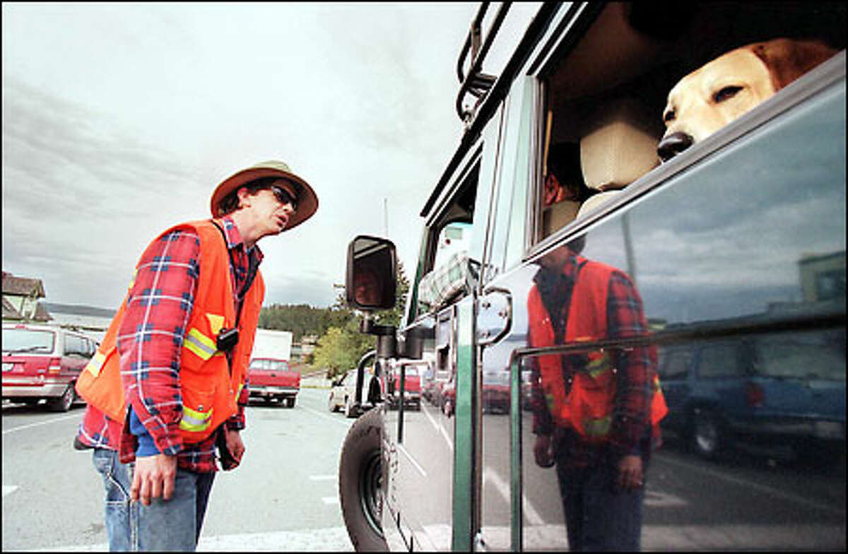Fourth-generation San Juan Islander Rawson Hirschel, a shift manager at the Friday Harbor ferry terminal, explains a boat cancellation to a Hummer-driving, retriever-hauling resident.
