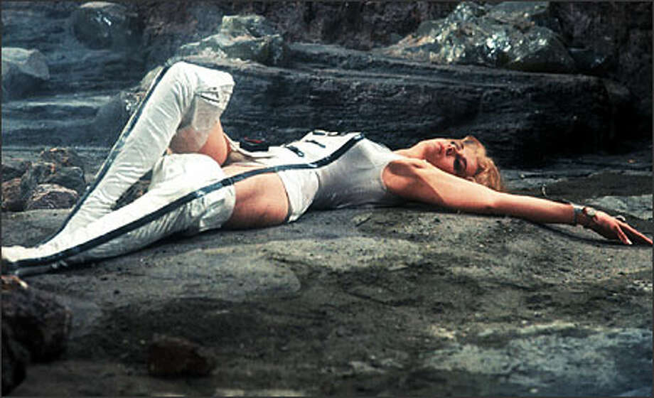 "Jane Fonda, seen here in the 1967 sci-fi fantasy ""Barbarella,"" didn't take Ted Turner's alleged infidelities lying down. But she was less tough with first husband Roger Vadim, the French director of ""Barbarella."" She reveals in her new book that she helped arrange some of his sexual adventures. A political activist, actress with two Oscars, and another career as an exercise guru, Fonda's autobiography can't possibly be dull. Photo: Associated Press / Associated Press"