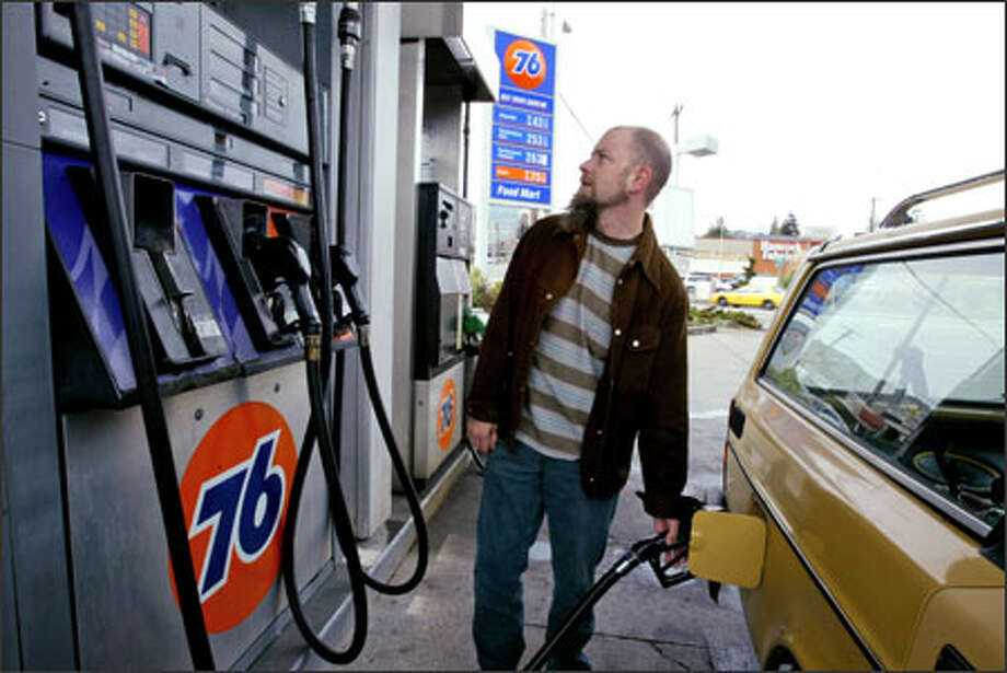 Gas is more expensive in Seattle than in most American cities, a new report has found. Photo: Seattlepi.com archive. Photo: Grant M. Haller, Seattle Post-Intelligencer / Seattle Post-Intelligencer