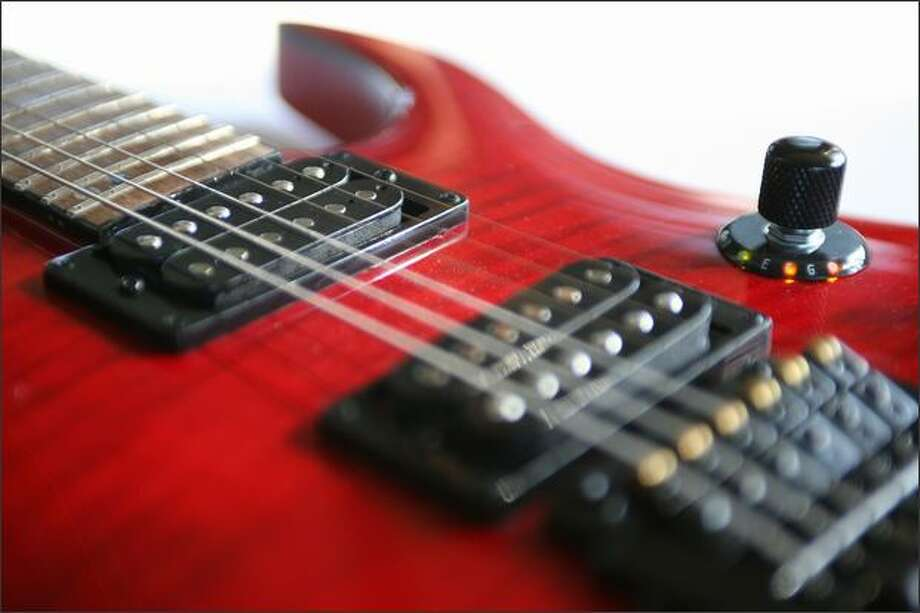 Zero Crossing's guitar tuner is mounted to the body of an electric guitar. The N-Tune is accurate to 2 percent of a note. Photo: Paul Joseph Brown, Seattle Post-Intelligencer / Seattle Post-Intelligencer