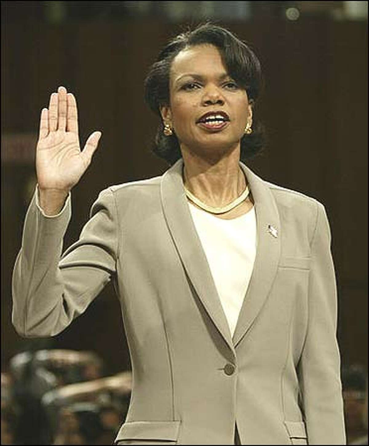 National security adviser Condoleezza Rice is sworn in before testifying to the independent commission investigating the Sept. 11 attacks (Thursday, April 8, 2004, AP Photo/J. Scott Applewhite)