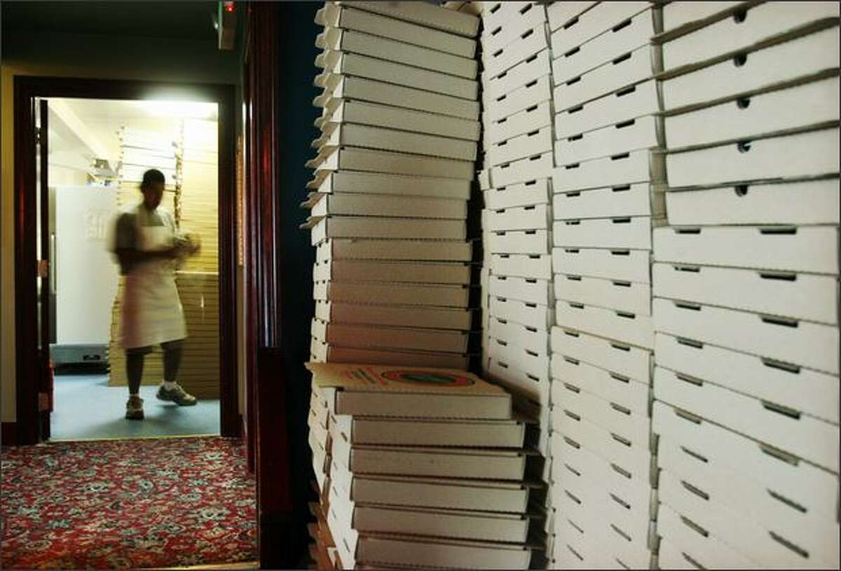 Pizza boxes stack up at Piecora's. The cost of the boxes has gone from 40 cents apiece to 60 cents.