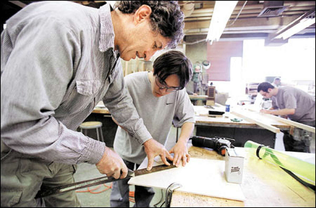 Badanes assists UW senior Daisuke Zaoya. Badanes' students head out into the city four times a week to design and execute low-budget, community-oriented design/build projects.