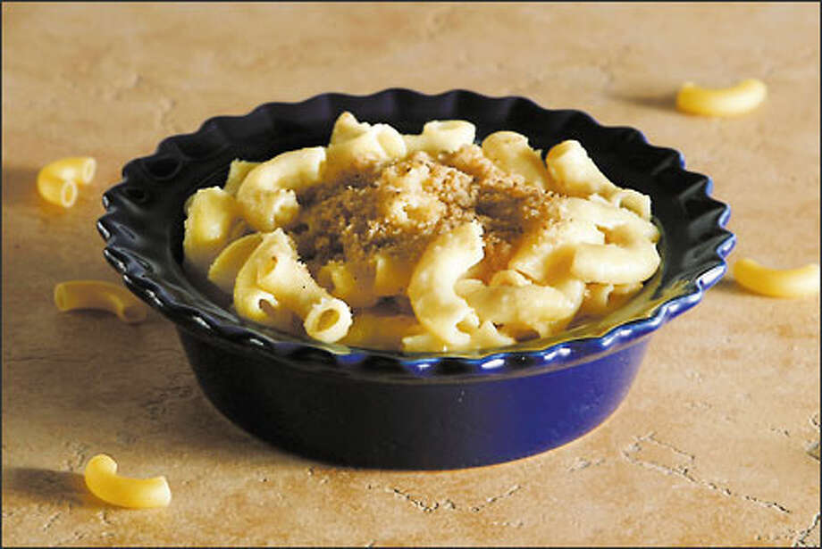Sweet Maa's Macaroni and Cheese Casserole is a custard-style version using eggs and sharp cheddar cheese. Photo: Meryl Schenker, Seattle Post-Intelligencer / Seattle Post-Intelligencer
