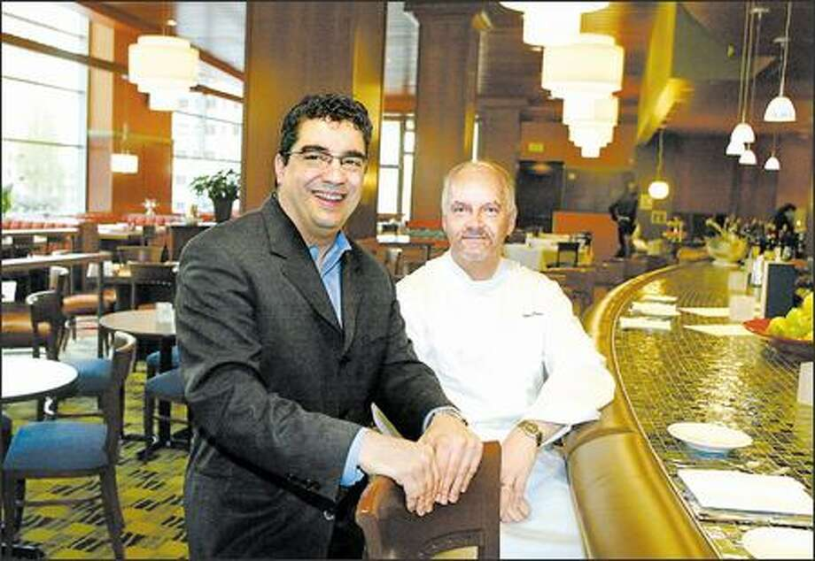 Rich Troiani, left, is a hands-on host with a knack for attracting a loyal following at his namesake restaurant, at which chef Walter Pisano creates many memorable dishes. Photo: Meryl Schenker, Seattle Post-Intelligencer / Seattle Post-Intelligencer