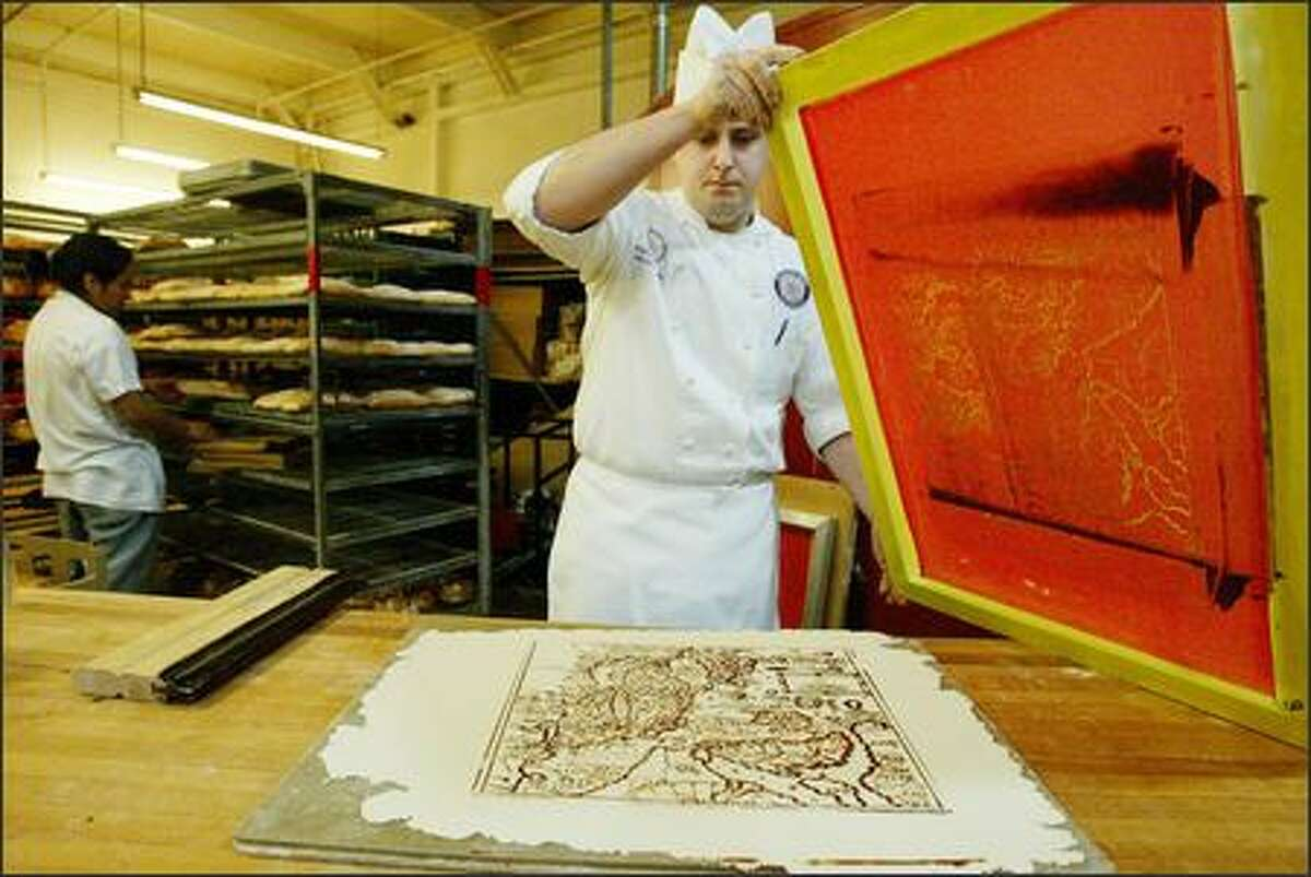 William Leaman, of Essential Baking Co. in Wallingford, silk-screens an old map onto pastry dough during a practice run for the World Cup of Baking in Paris.