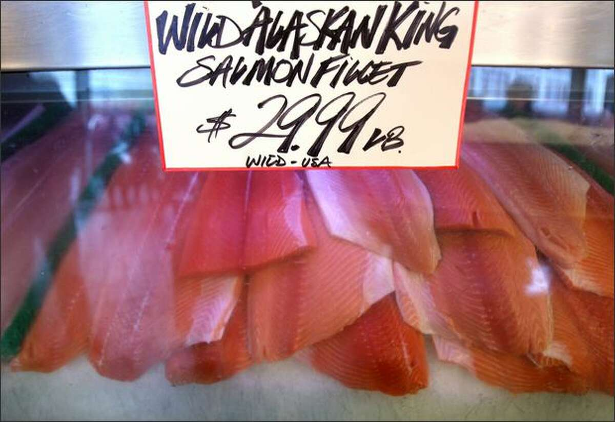 How high can it go? Shoppers at Pike Place Market on Tuesday paid this for wild salmon.