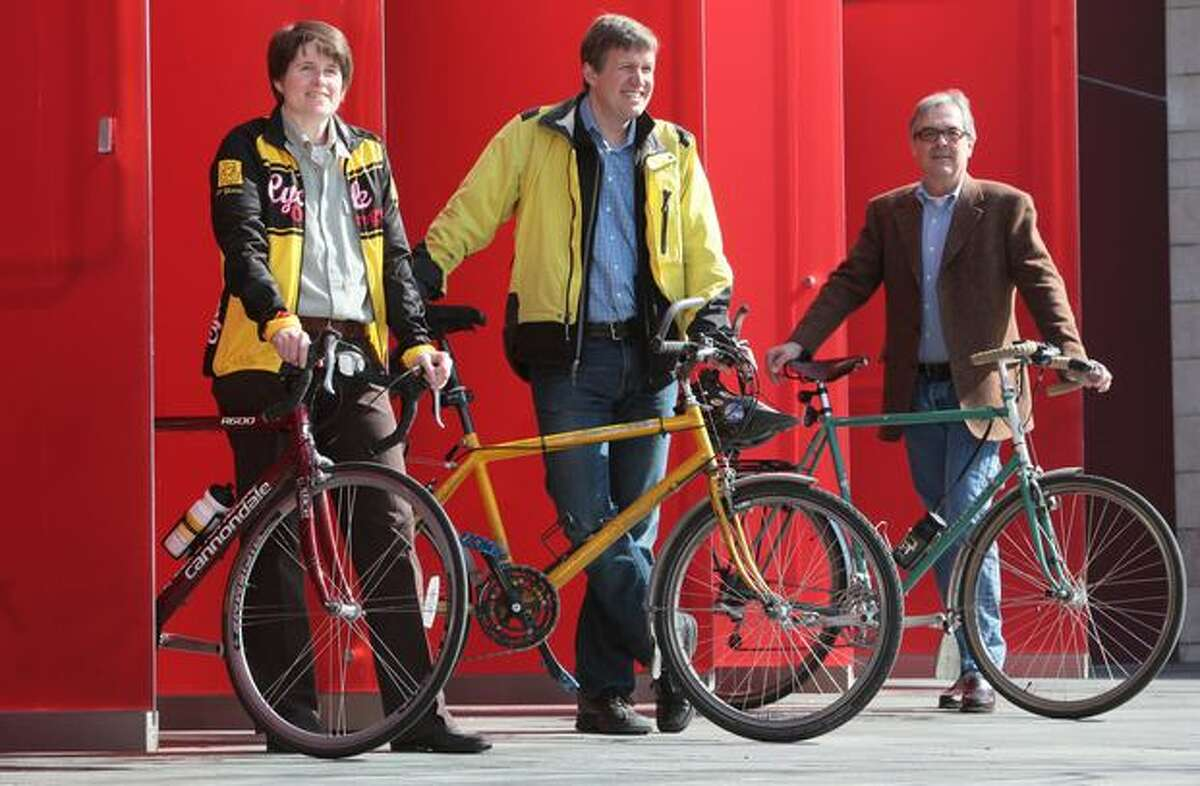 City Councilmembers Sally Clark and Mike O'Brien are among the officials who regularly bike to work.