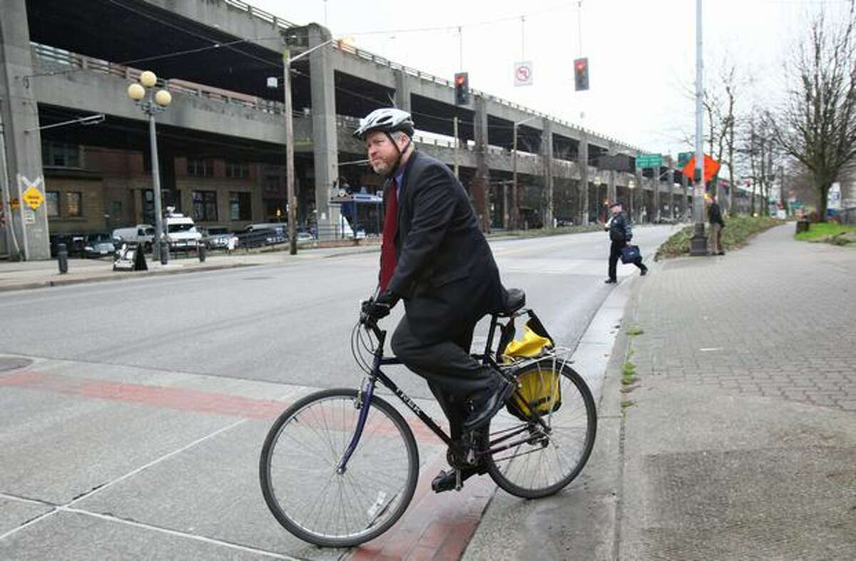 Mayor Mike McGinn bikes away from a news conference in front of the Alaskan Way Viaduct in January.