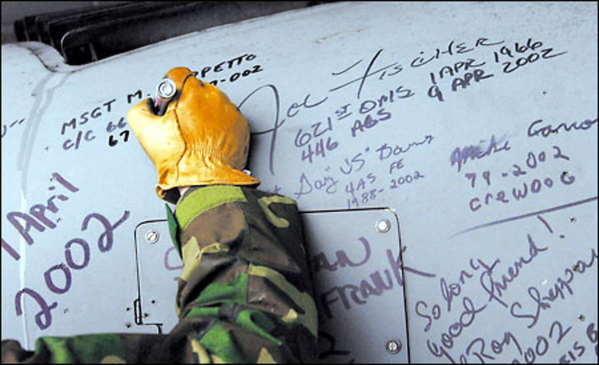 Anyone who was present and ever had anything to do with the plane during its 36 years at McChord Air Force Base got to sign tail No. 50267 before the C-141B left for Arizona and mothballs.