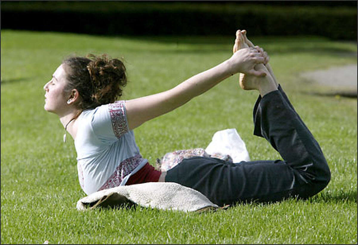 Shaina Traisman practices her yoga on the lawn at Volunteer Park across from the Asian Museum yesterday. She had just returned from her final class in a teacher's certification course and since it was a nice day she decided to get in a little more practice before sunset. Today should be another yoga day in the Puget Sound area, weather forecasters say.