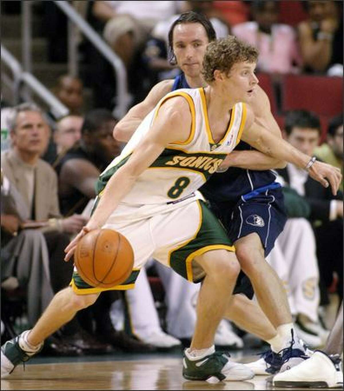 Seattle SuperSonics' Luke Ridnour drives around Dallas Mavericks' Steve Nash in the first half in Seattle, Saturday, April 10, 2004. Ridnour had 16 points and a career-high 13 assists in the Sonics' 119-99 win. (AP Photo/John Froschauer)