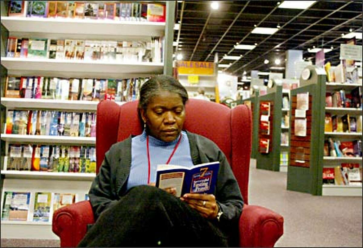 Janice Brown of Renton shops at the Evangel Bookstore in Bellevue. This is a busy season for Christian stores.
