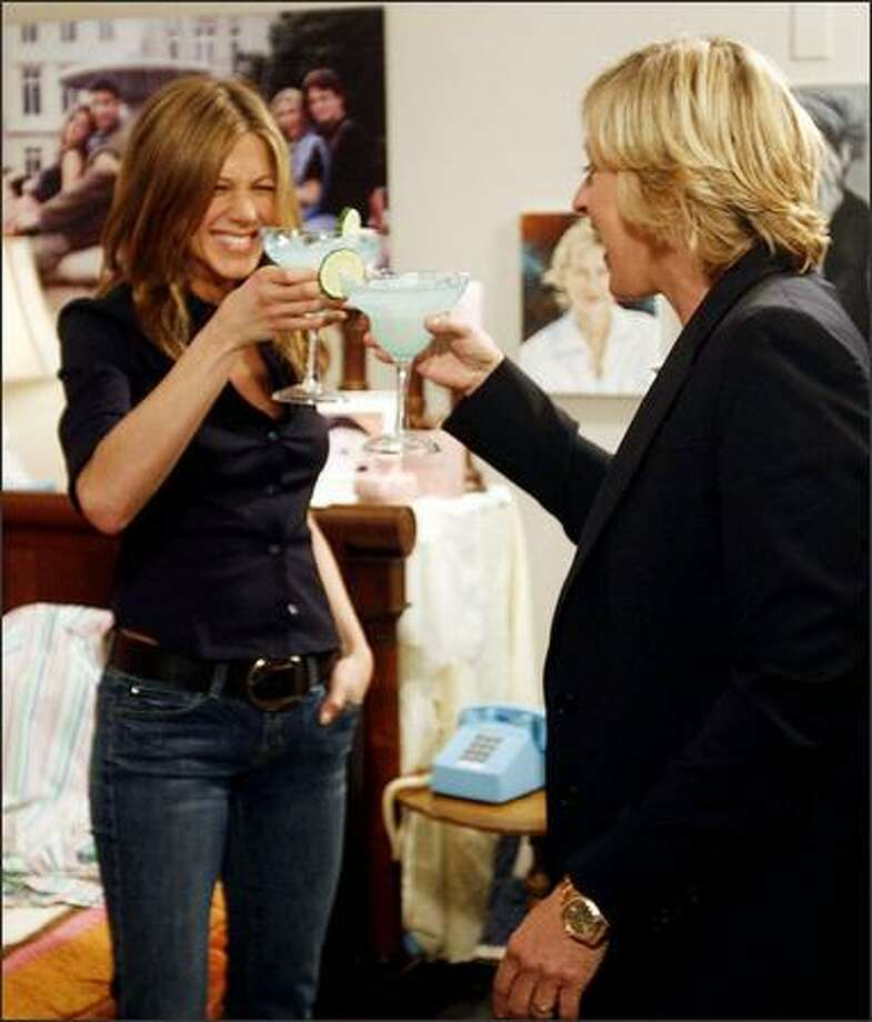 """Another reason to love Ellen: She provides housing for her celebrity friends. On Friday, the popular talk-show host unveiled her surprise to guest Jennifer Aniston -- a custom-made backstage suite decorated with """"Friends"""" pics and portraits of herself. DeGeneres presented it to Aniston as a paparazzi-free zone. Photo: Associated Press / Associated Press"""