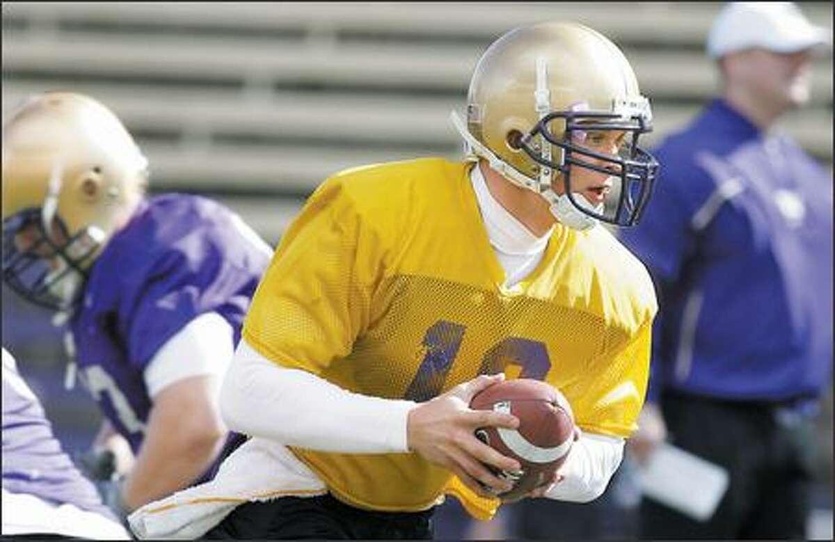 University of Washington's quarterback Jake Locker during the teams first spring football practice on Monday at Husky Stadium.
