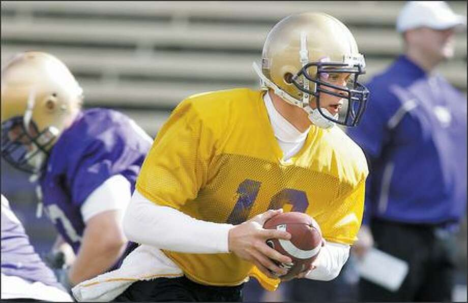 University of Washington's quarterback Jake Locker during the teams first spring football practice on Monday at Husky Stadium. Photo: Gilbert W. Arias, Seattle Post-Intelligencer / Seattle Post-Intelligencer