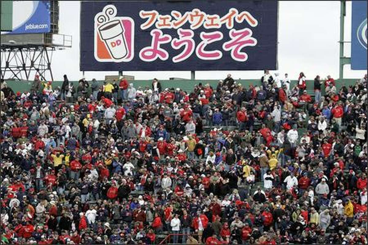 A Dunkin' Donuts billboard spells out a welcome in Japanese during opening day at Fenway Park in Boston, where new Red Sox pitcher Diasuke Matsuzaka is creating the same kind of buzz Ichiro Suzuki did in Seattle back in 2001.