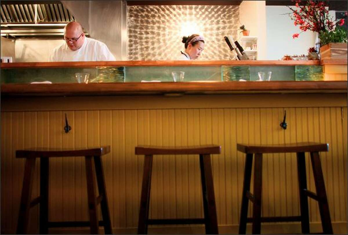 Michael Whisenhunt, left, and chef/co-owner Rachel Yang work the counter at Joule in Wallingford. Young, a former chef at Madrona, brings a cross-cultural style to the restaurant.
