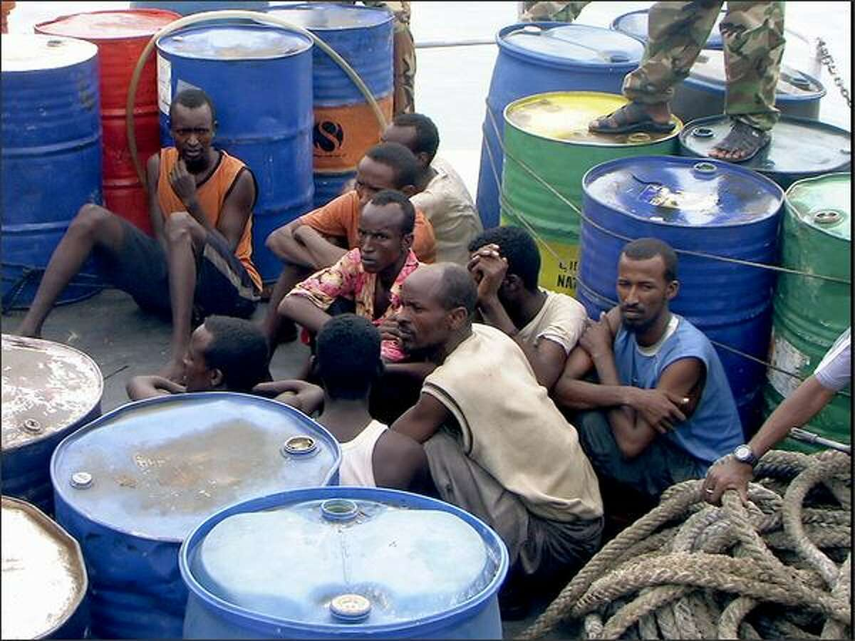 In this Nov. 21, 2008 file photo, Somali pirates held by Puntland police forces, sit in Bassaso, Somalia. They've been described as