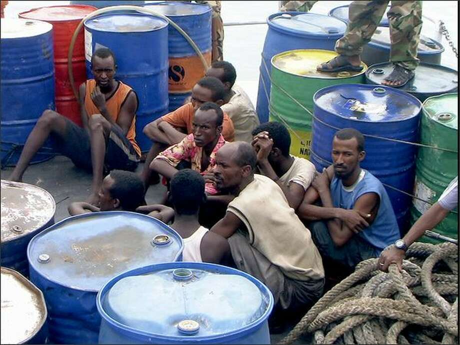 "In this Nov. 21, 2008 file photo, Somali pirates held by Puntland police forces, sit in Bassaso, Somalia. They've been described as ""noble heros"" by sympathetic Somalis, denounced as criminals by critics. Photo: Associated Press / Associated Press"