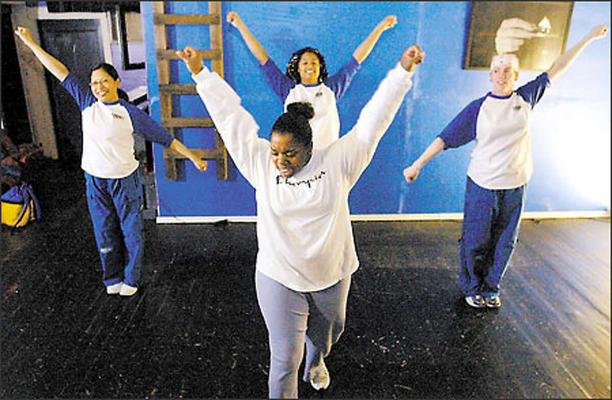 Members of Cheer Seattle, from left to right, Mary Jane Mancilla, Nadiah Buckner, Nakema Jones and Sunday White, practice one of their routines in Seattle.