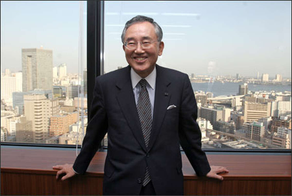 Yoshihiko Miyauchi, chairman and chief executive officer of Orix Corp., a financial services giant, is shown in his Tokyo office. Miyauchi earned an MBA at the UW.