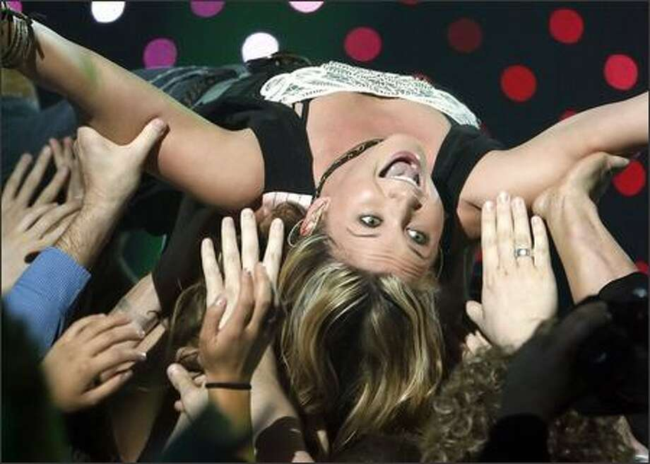 "Crowd diving is so Pearl Jam 15 years ago! But apparently Sugarland's Jennifer Nettles didn't get the memo, as she engaged in the ultimate trust exercise at the CMT Music Awards Monday night in Nashville. She took home an award for Collaborative Video of the Year with Bon Jovi, ""Who Says You Can't Go Home."" Photo: Associated Press / Associated Press"