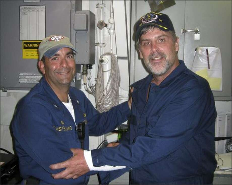 This photo released by the U.S. Navy shows Maersk Alabama Capt. Richard Phillips, right, standing alongside Cmdr. Frank Castellano, commanding officer of the USS Bainbridge, after being rescued by U.S. Naval Forces off the coast of Somalia.  Phillips had been held hostage for days by pirates who boarded and briefly took control of his ship several days earlier.  (AP Photo/U.S. Navy photo) Photo: Associated Press / Associated Press