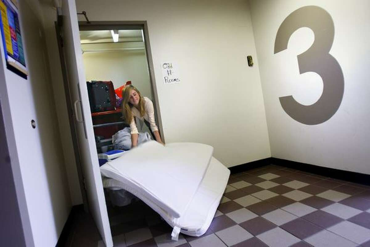 A student moves her belongings into McCarthy Hall at the University of Washingtion in this September 2008 file photo. The university plans to spend $850 million revamping student housing.
