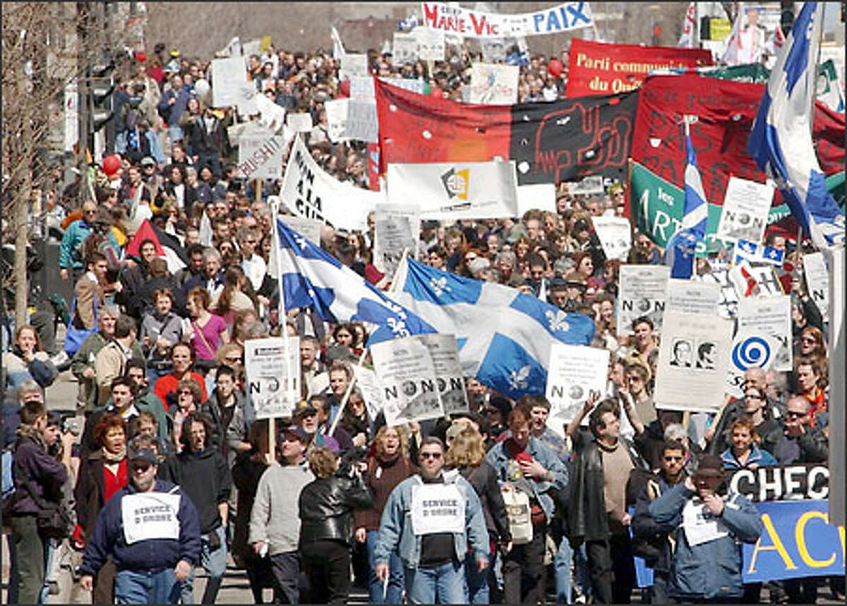 Thousands of protesters march on Rene-Levesque Boulevard in downtown Montreal during a demonstration against the war in Iraq on Saturday.