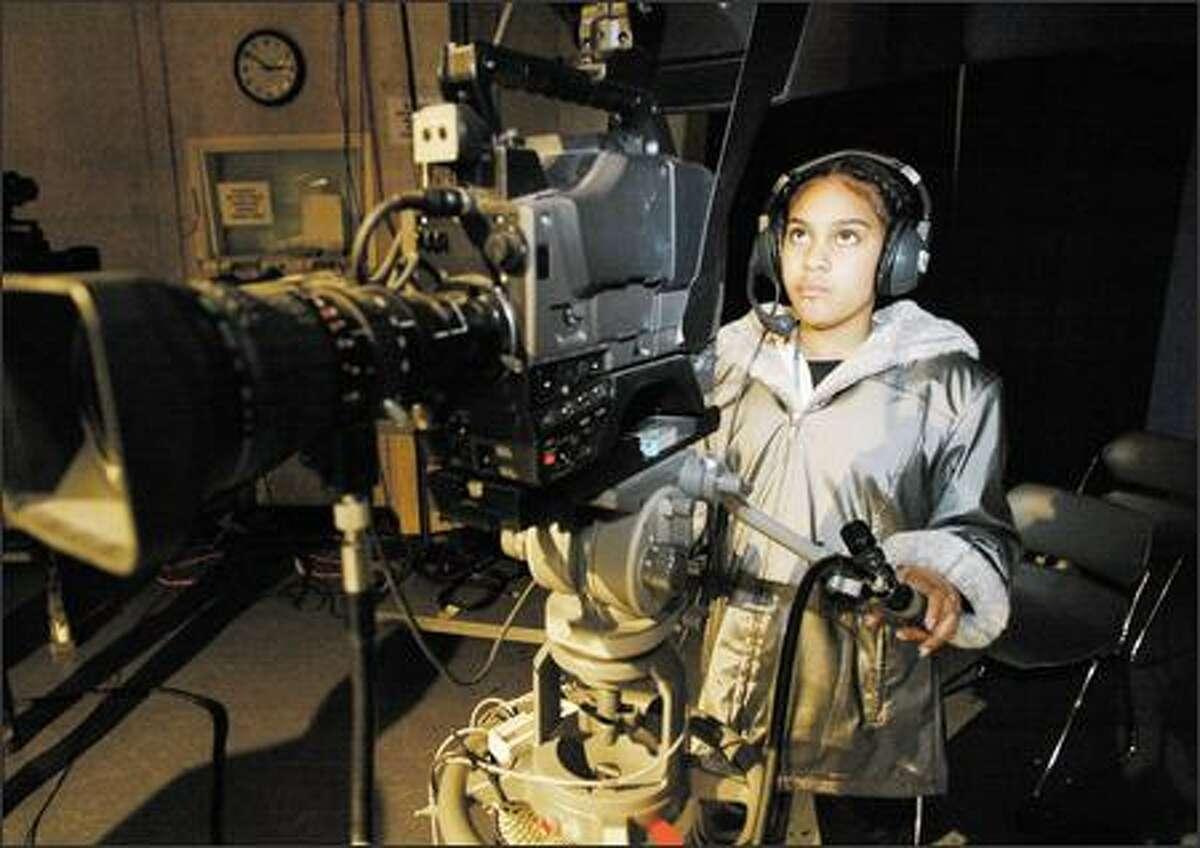 Rachel Johnson, 13, films a peer doing her