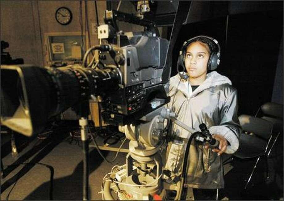 "Rachel Johnson, 13, films a peer doing her ""When I look in the mirror"" monologue as part of the Reel Grrls program. Photo: Meryl Schenker, Seattle Post-Intelligencer / Seattle Post-Intelligencer"