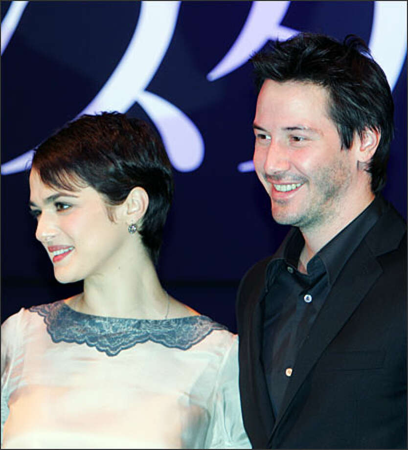 "Rachel Weisz and Keanu Reeves are in Japan this week promoting their film ""Constantine."" It's a light-hearted effort to celebrate a very dark film: The R-rated movie has been called a ""demonish thriller"" with Reeves as a ""hard drinking, hard living"" and bitter hero. (KOJI SASAHARA/AP) Photo: Associated Press / Associated Press"