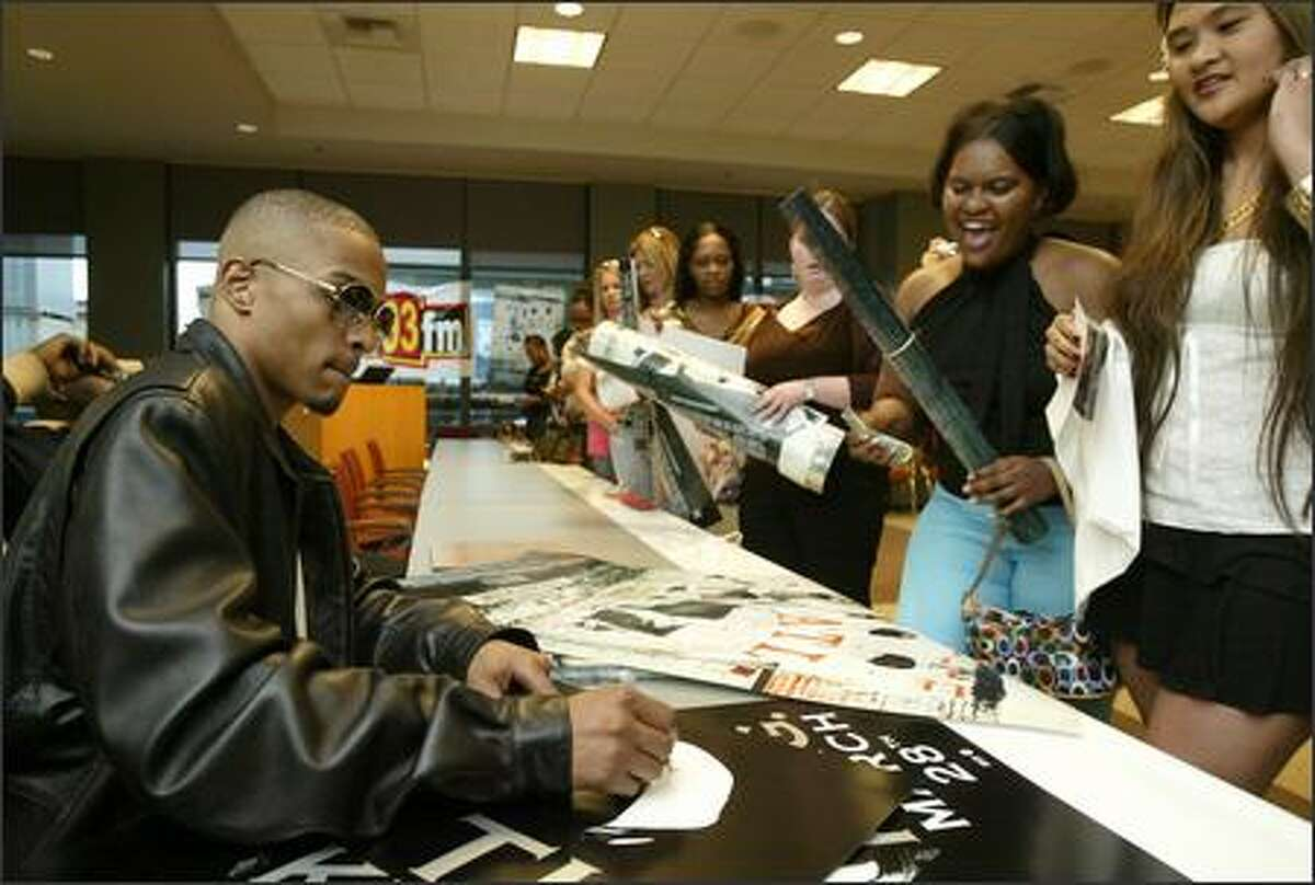 KUBE-FM Contest winners lined up to receive rapper T.I.'s autograph at the radio station office April 7. T.I.'s latest album,