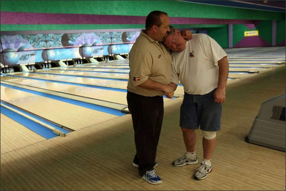 Roy Lynch, right, and Bob Davidson share a moment as their time at Sunset Bowl comes to an end Sunday. Lynch's memories there include proposing to his first wife. Davidson's father once managed the business: