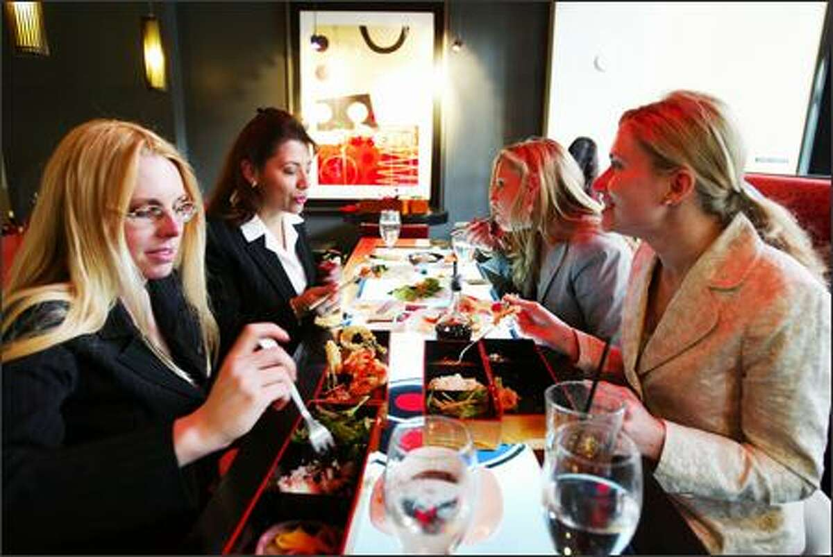 Conventioneers from around the country, from left, Amy Ragone, Adriana Sanchez, Danika Ramberg and Fran Reinhardt, enjoy bento boxes, tempura and a sushi sampler.