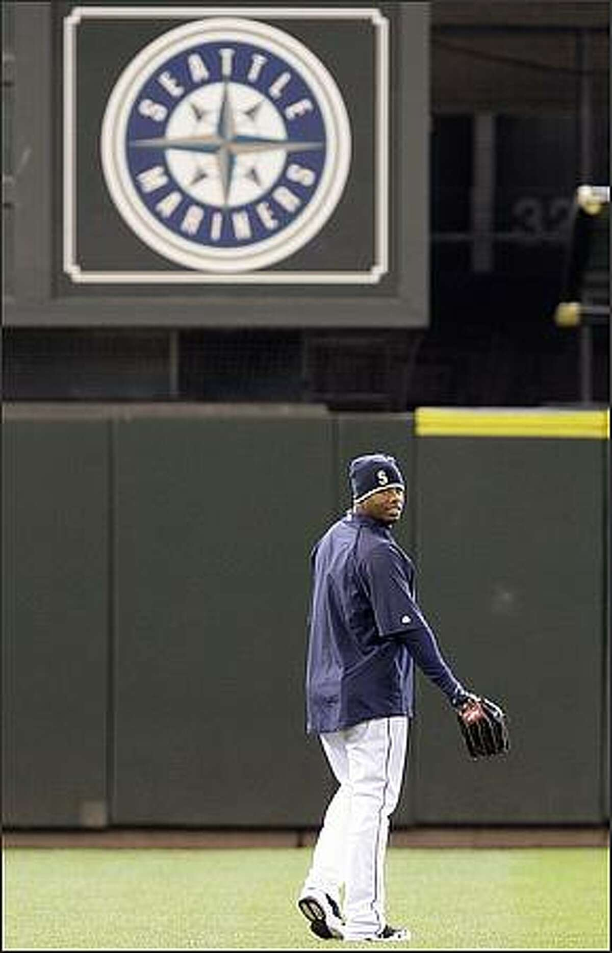 Seattle Mariners' Ken Griffey Jr. heads to the outfield during a baseball workout Monday, April 13, 2009, at the the team's ballpark in Seattle. The Mariners open their home season Tuesday against the Los Angeles Angels. The game will be the Griffey's first home game playing for the Mariners in almost 10 years. (AP Photo/Elaine Thompson)