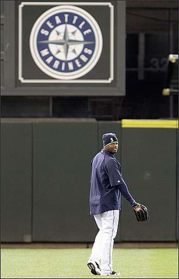 Seattle Mariners' Ken Griffey Jr. heads to the outfield during a baseball workout Monday, April 13, 2009, at the the team's ballpark in Seattle. The Mariners open their home season Tuesday against the Los Angeles Angels. The game will be the Griffey's first home game playing for the Mariners in almost 10 years. (AP Photo/Elaine Thompson) Photo: Associated Press / Associated Press