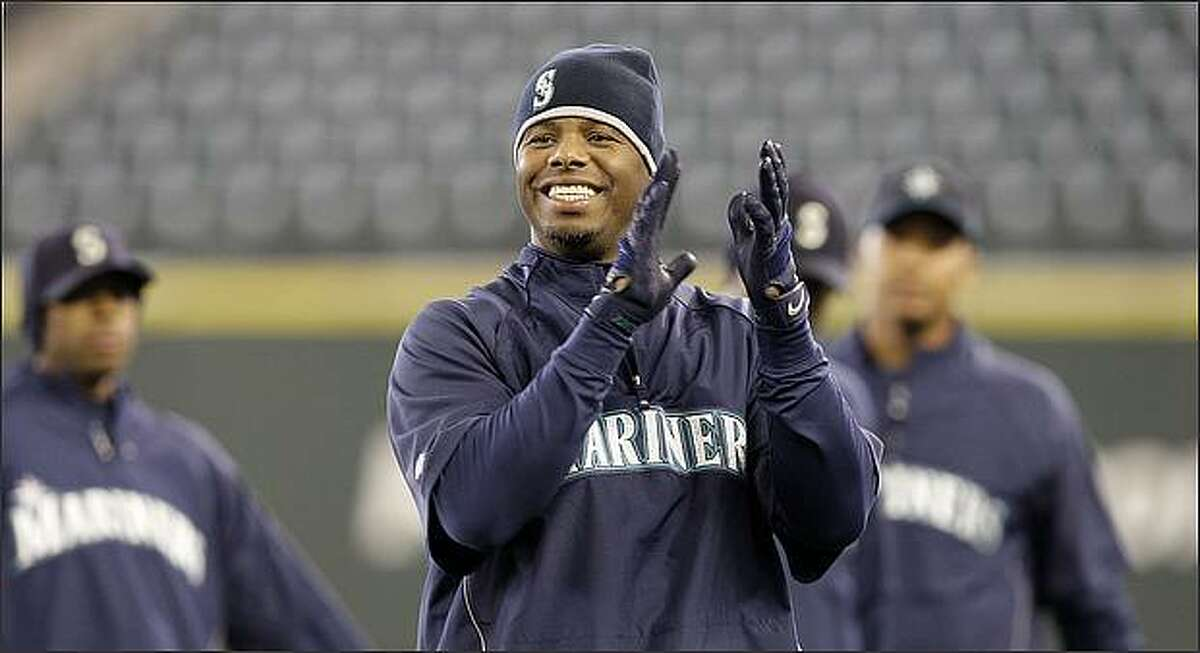 Seattle Mariners' Ken Griffey Jr. claps as he begins a workout Monday at Safeco Field. The Mariners open their home season Tuesday against the Los Angeles Angels. (AP Photo/Elaine Thompson)