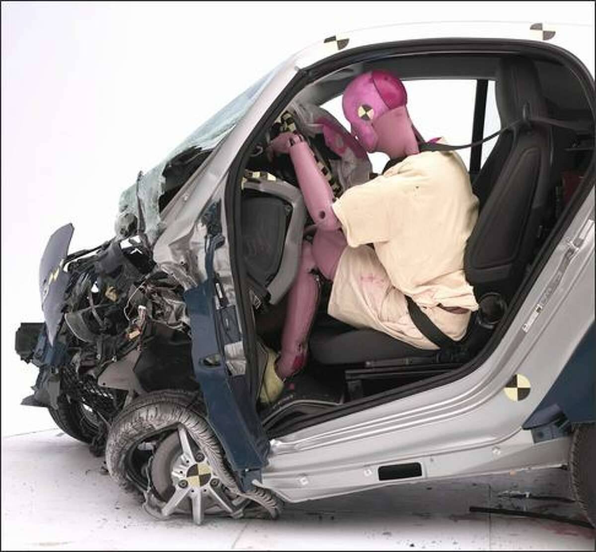 This handout photo provided by the Insurance Institute for Highway Safety shows a 2009 Smart Fortwo after the Institute's 40-mph frontal offset crash. Tests found that drivers of 2009 versions of the Smart fortwo, Honda Fit and Toyota Yaris could face significant leg and head injuries in severe head-on crashes with mid-size vehicles. (AP Photo / IIHS)