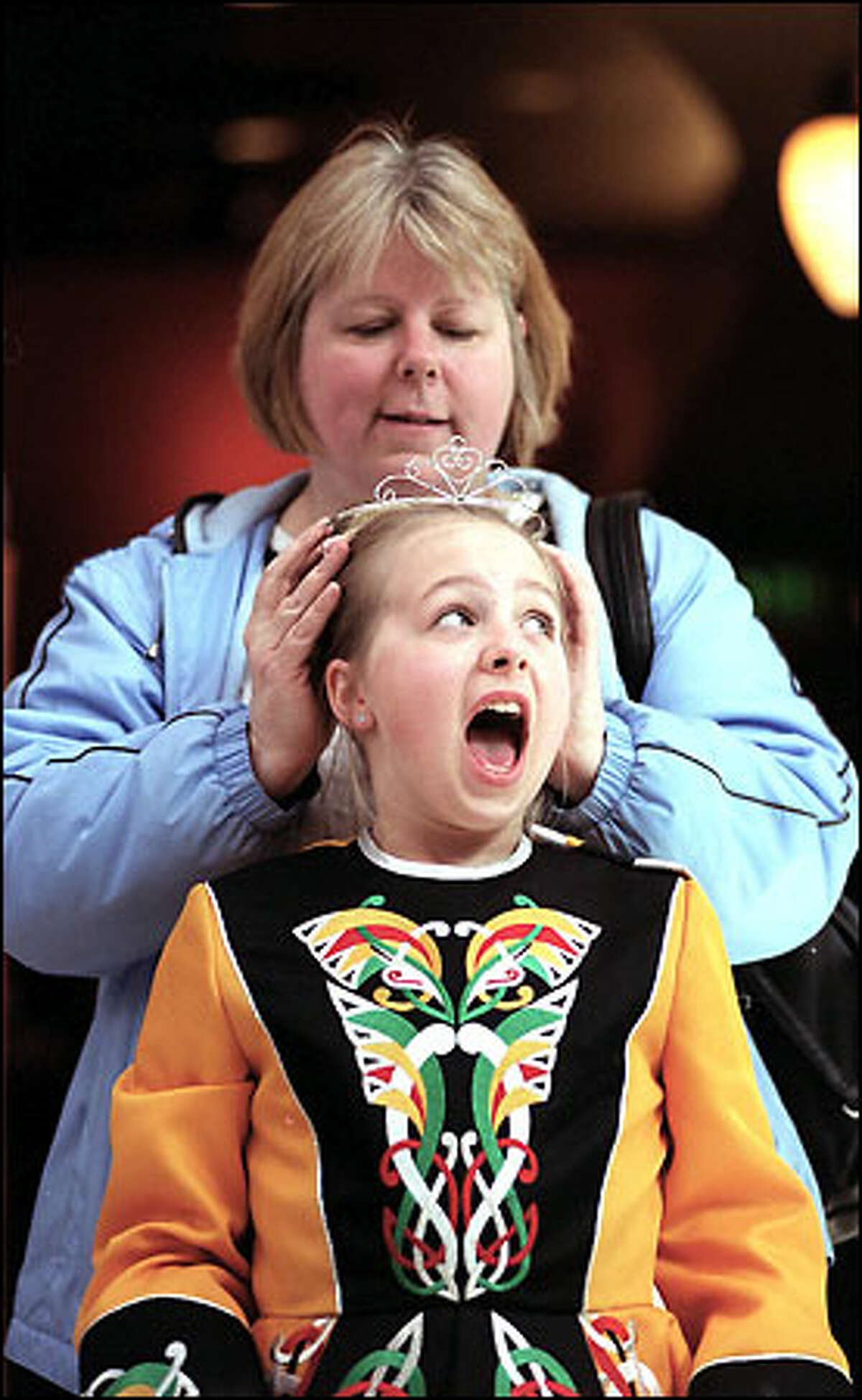 Shannon Malnes, 9, teases mom Carol that her crown, part of an Irish dance costume, is tangled - it was fine. Shannon is part of Comerford School of Irish Dance.