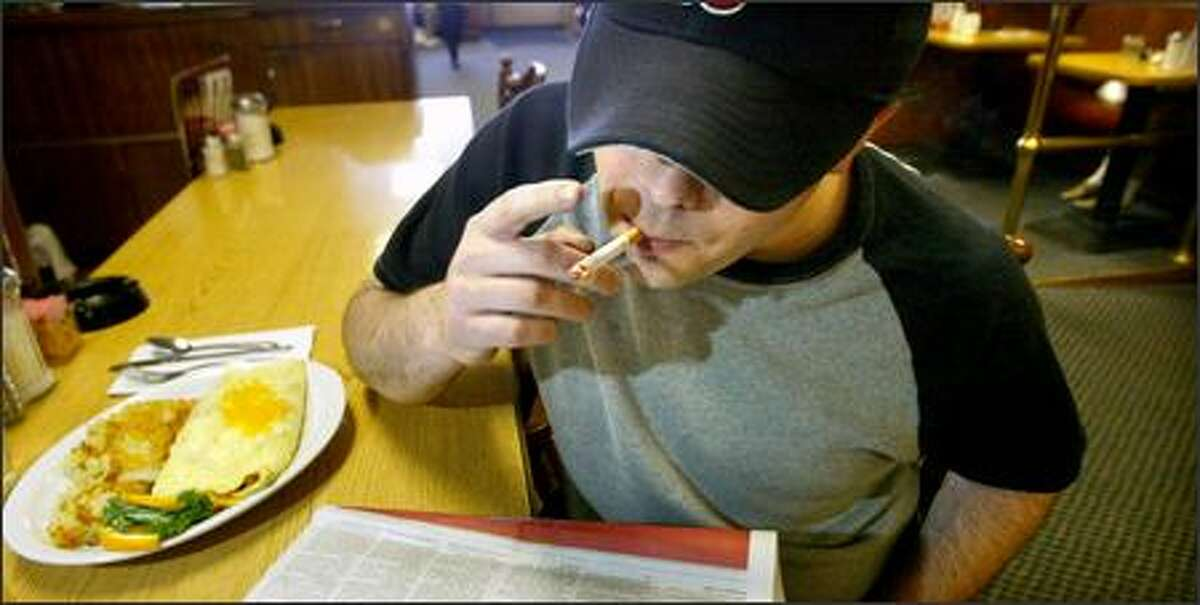 Curtis Thorfinson of Seattle eats at the Ballard Smoke Shop, a restaurant and bar,